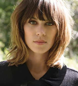 basically EXACTLY THIS incl. color, hair, length, bangs--maybe a little more bang like the photo to the right