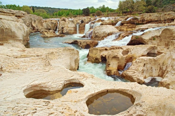 Cascades Sautadet. At the foot of La Roque-sur-Ceze, one of the most beautiful villages in France , the Cèze river has shaped a limestone plateau to form the Sautadet waterfalls, an exceptional natural site where lovers of relaxation and adventurous divers find happiness. © lamax - Fotolia.com