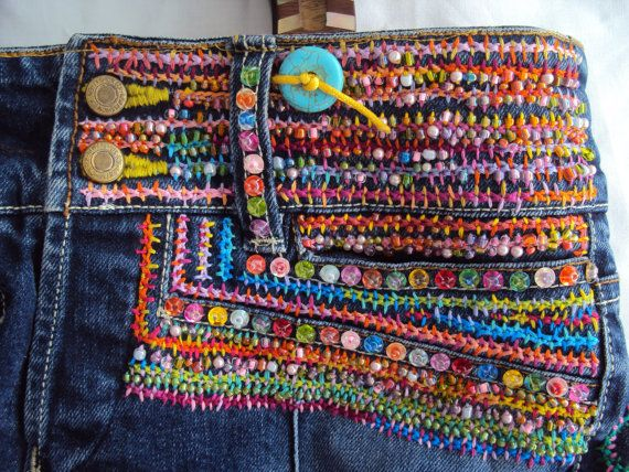SALE was priced at $350 now $299. The ultimate jean bag. Colorful hand embroidered with beads and sequins all over bag. OOAK handcarved shell inlay teak handles, with turquoise disc buttons. Fully lined, 3 exterior pocket one of which is the brass button closing fly, 3 interior pockets, 2 with zippers and beaded zipper pulls. Special hook for easy to find keys.    Free shipping on this very special OOAK handbag.