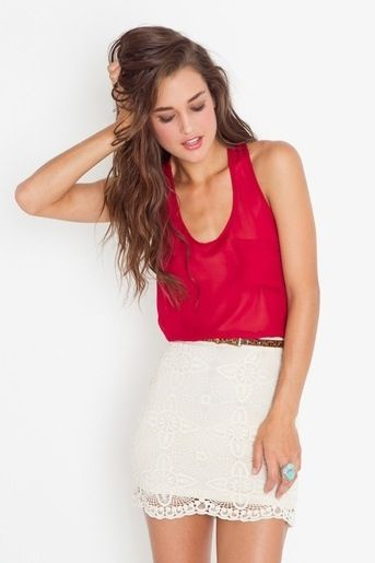 Red top is already beautiful on its own and adding a white skirt covered with a layer of big floral lace is a great match. A simple leopard skin belt and blue ring accessorise this cute outfit making it casual and elegant. ☮
