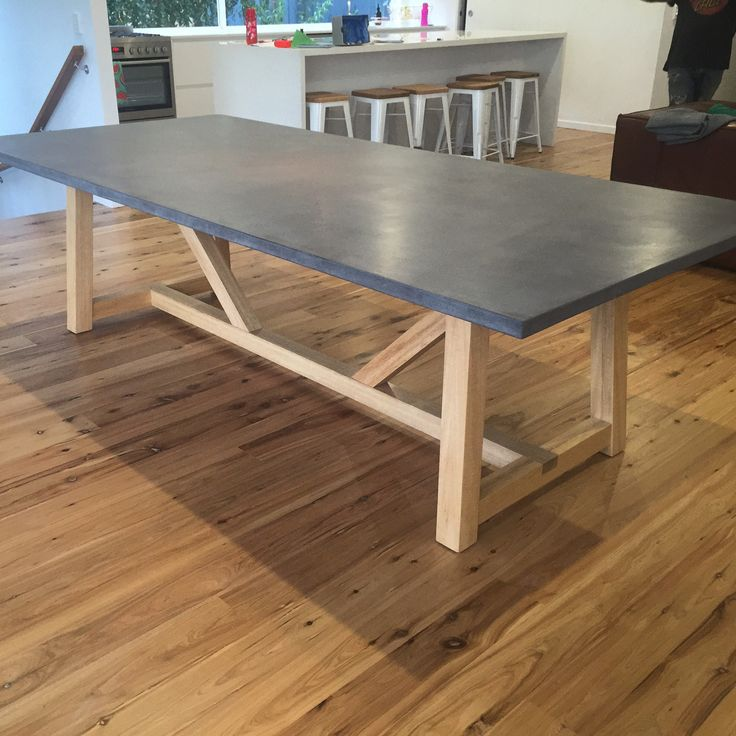 Concrete top and White mahogany base.  the perfect piece for a great dinning room