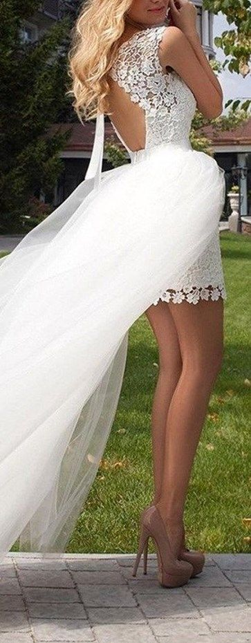 SUPERB! This mini wedding dress is so cute with the lace floral appliques! The detachable tulle skirt make it so sexy... Sold by Amazon: http://www.cutedresses.co/go/Sexy-Lace-Backless-Short-Wedding-Dress