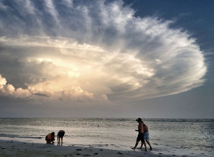 Storm's Backside: Evening stroll on Siesta Key Beach in Sarasota, Florida -- voted no. 1 beach in the country. (© Judy Robertson/National Geographic Photo Contest)