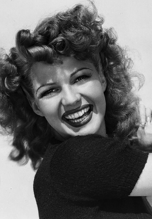 Rita Hayworth - the hair in this shoot is fabulous. I love the big wide smile