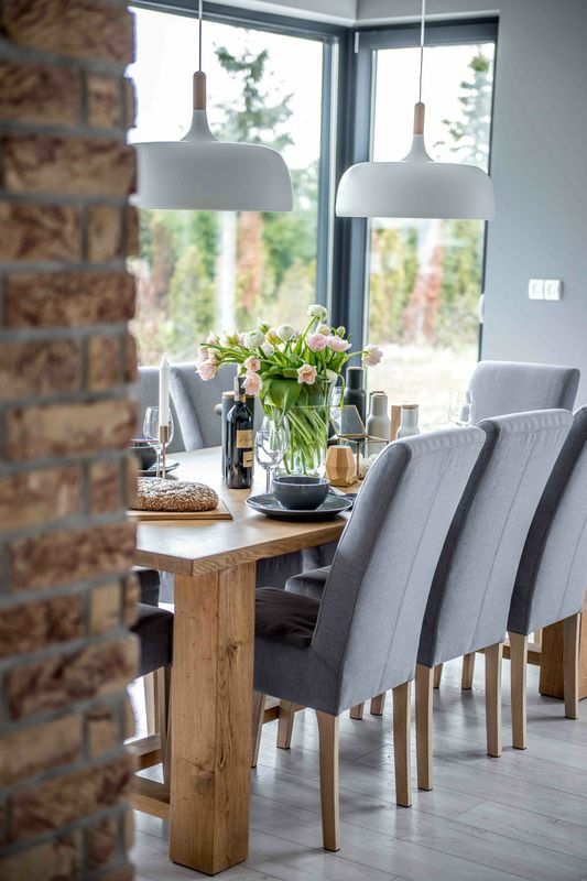 Love the textures: wool, brick, wood. A bit too grey and monotone for my taste. Nordic gray modern home interior design 3