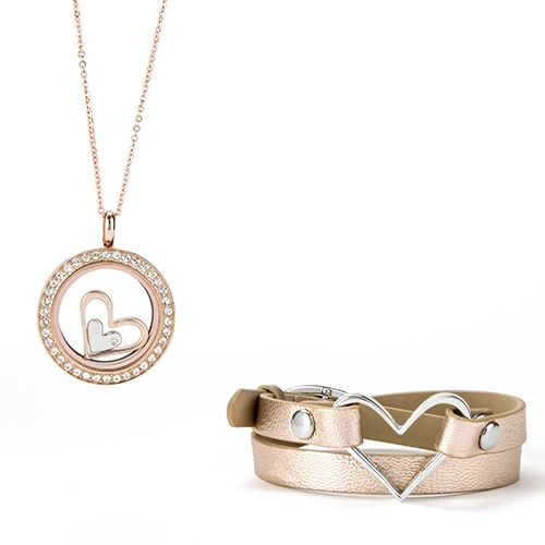 Tell your teacher you think she has the biggest heart with our exclusive Origami Owl Nesting Hearts with Swarovski Crystal Accent--wear it two different ways for a complete look! Featuring a rose gold hue, she'll feel the love every time she wears her new Genuine Leather Wrap Bracelet and Living Locket.