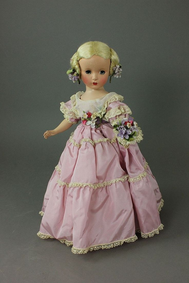 "14'' MADAME ALEXANDER ""GODEY LADY"" IN TAGGED ORIGINAL GOWN Description: very good outfit appears complete including socks, shoes, nosegay, and flowers in hair. Some uneven skin tone to face. Good original hair. Nice example of hard-to-find 1950 doll."