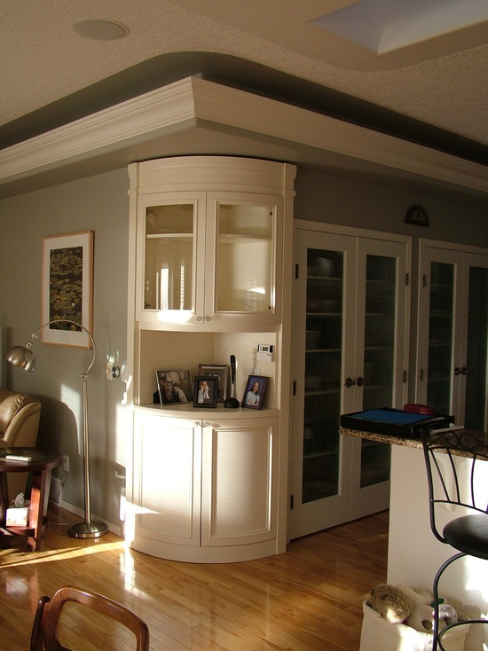 curved corner cabinet. Perfect spot for coffee maker and mugs