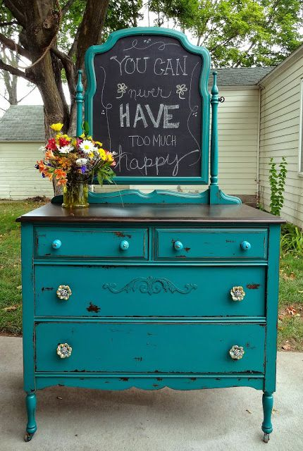 Chippy Teal Dresser at Create Inspire -- I like the idea of painting over the place for the mirror (or the mirror!) with chalkboard paint.