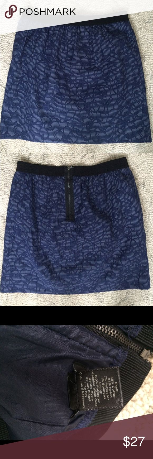Navy blue floral Ann Taylor skirt 10 P petite This skirt is in excellent, like new condition. The design is a black and navy floral print. It has a zipper in the back. The shape of the skirt is an A-line. This is a petite skirt, although it can also fit a regular size. Ann Taylor Skirts A-Line or Full