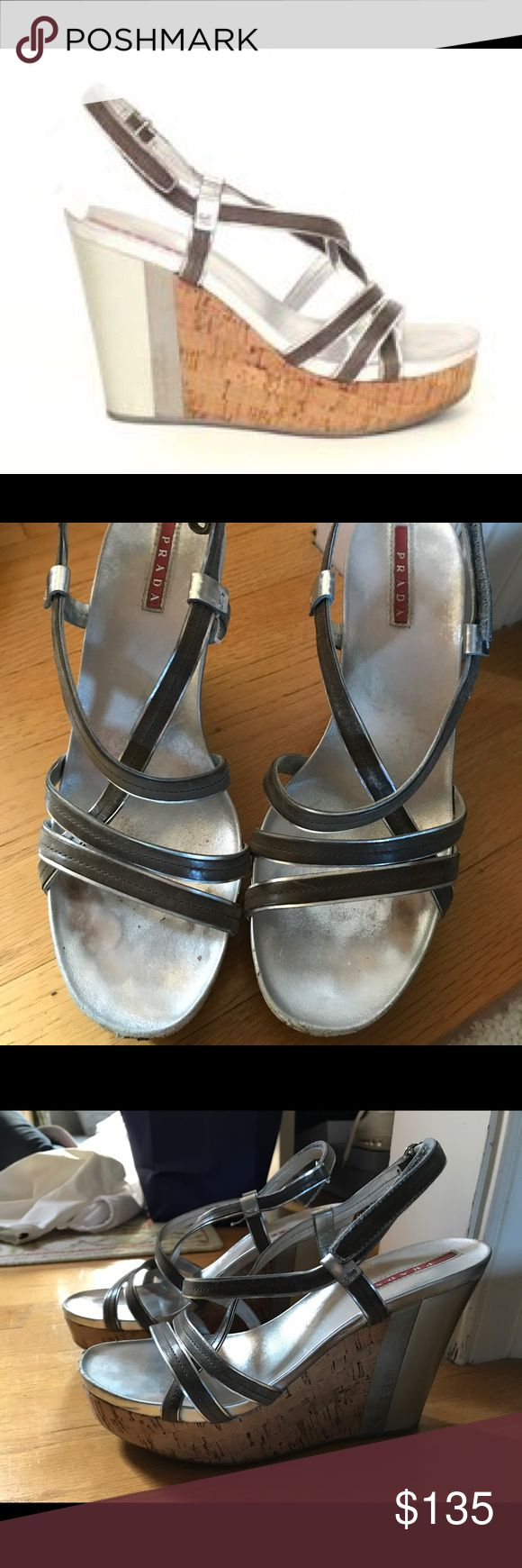 """Prada wedge sandals (size 38 1/2) Prada silver wedge sandals. Heel is 4 1/2"""". Worn a lot (they are so comfortable) so shoes have normal wear and tear but no real damage. Sold with shoe bags and box. Prada Shoes Wedges"""