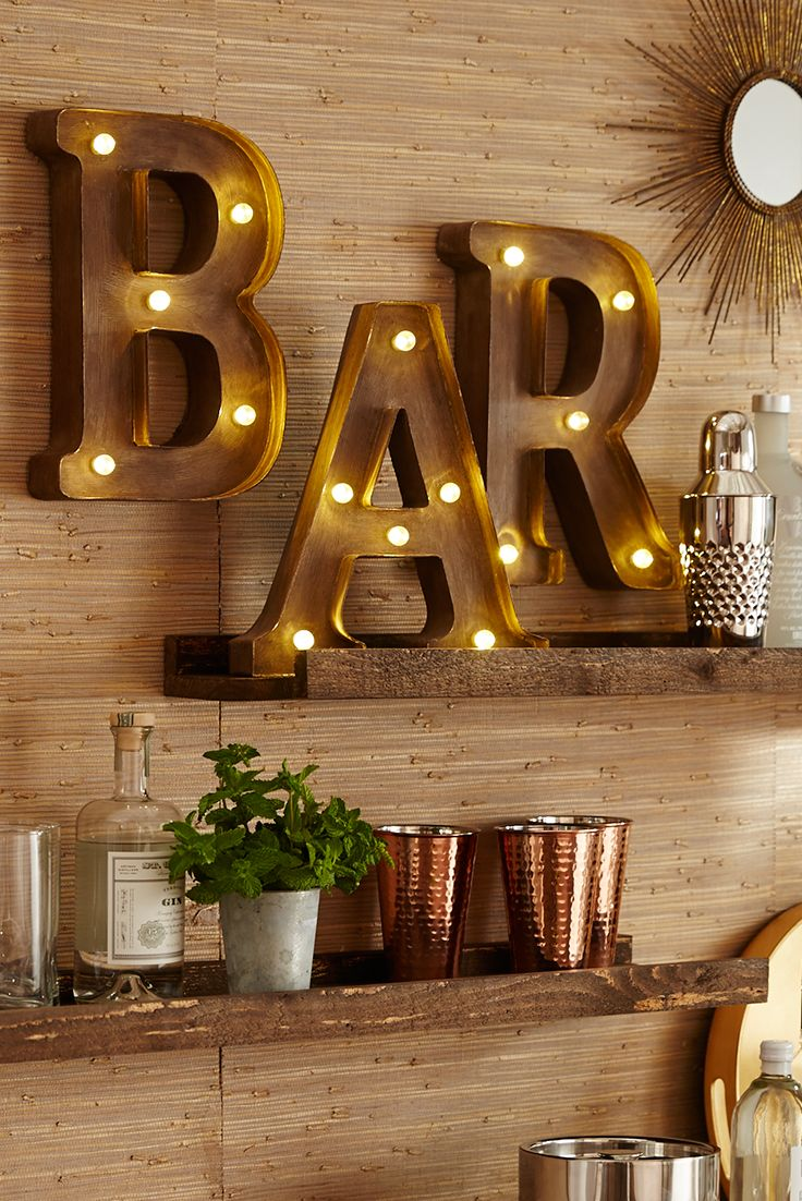 "Pier 1's LED-equipped Marquee Wall Letters will help you make a stylish statement to your Thanksgiving guests—like ""Here's the bar,"" for example."