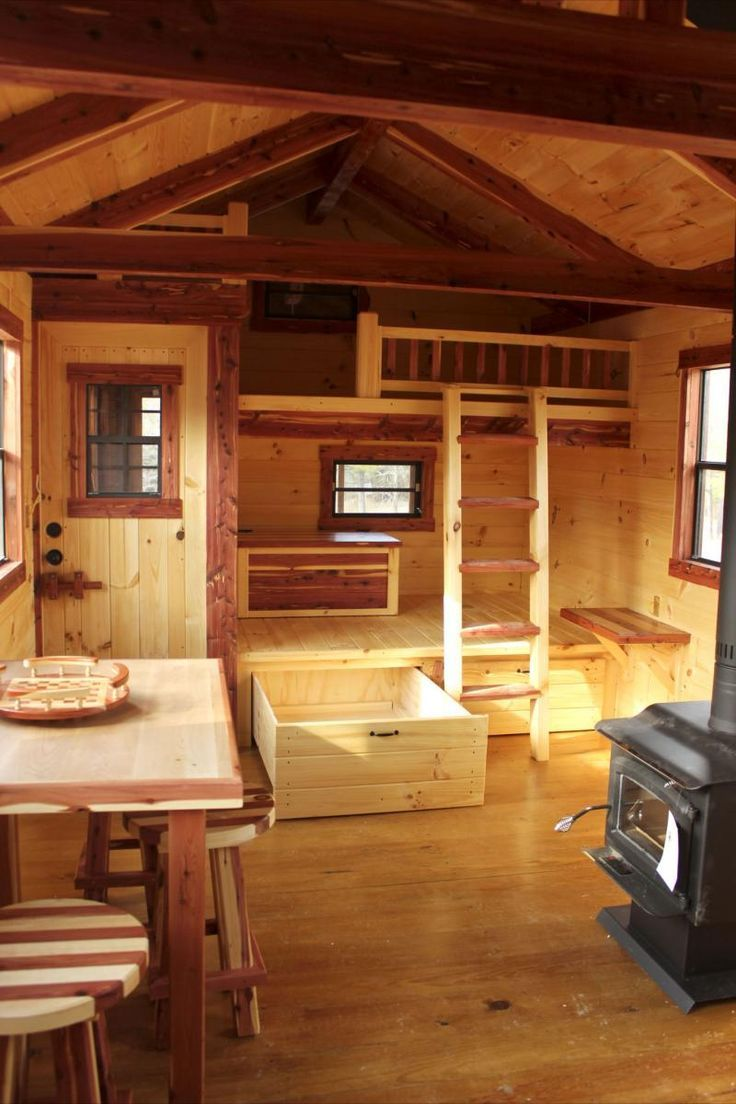 Ideas to be had here for sleeping options for those who do NOT want a loft (or who need more than a loft)...Amish built cabin.