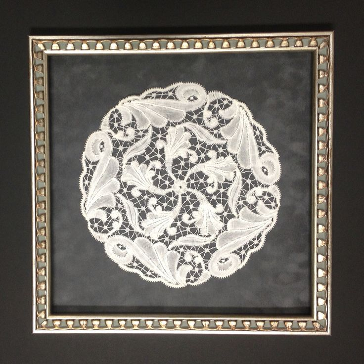 Another beautifully framed antique doily. I love how the pattern in the frame mimics some of the patterns in the lace