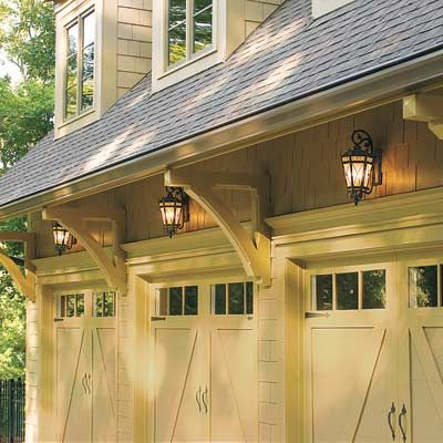 The garage can take up one-third of the average home's street-side facade, so even a small improvement makes a big impact. Install sconces, and you'll improve both the look and safety of this critical entry point. | thisoldhouse.com