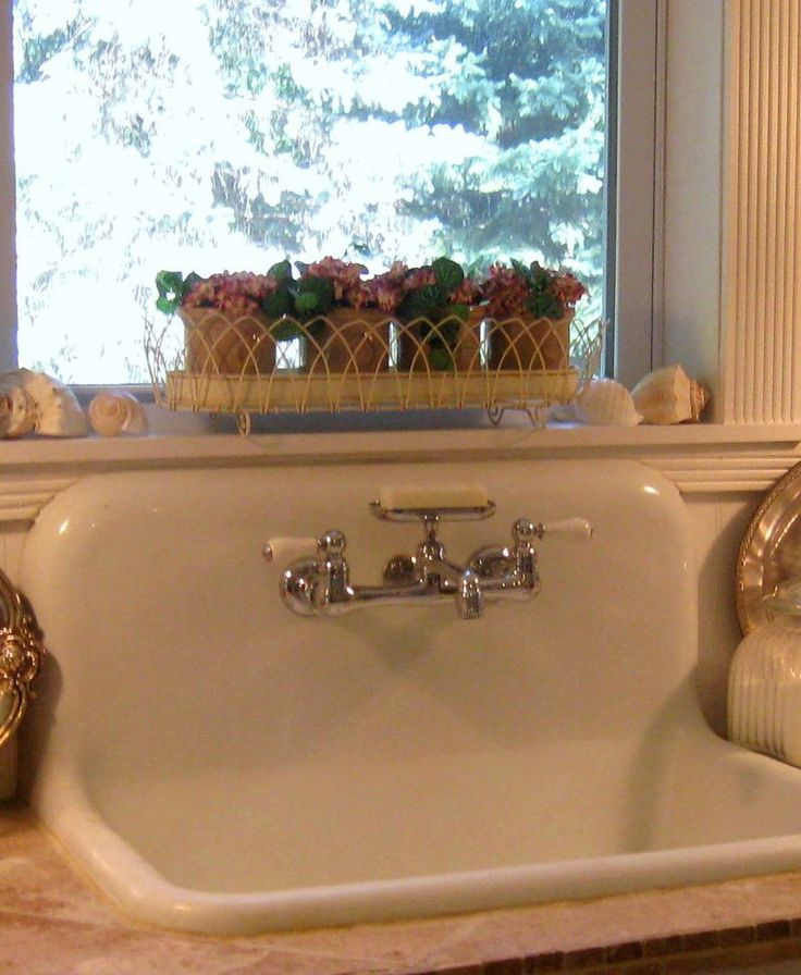 I have a baby version of this sink we found up in the attic space, complete with the faucet. I want one for the kitchen too...so bad!