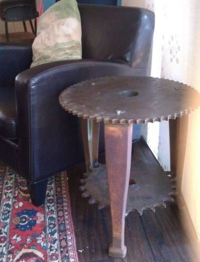 Recycled Metal Projects - machine gear made into end table