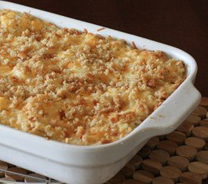 Hash Brown Casserole - This delicious hash brown casserole is perfect for a large dinner or potluck gathering. Use light sour cream and soups to make this delicious casserole a bit lighter.