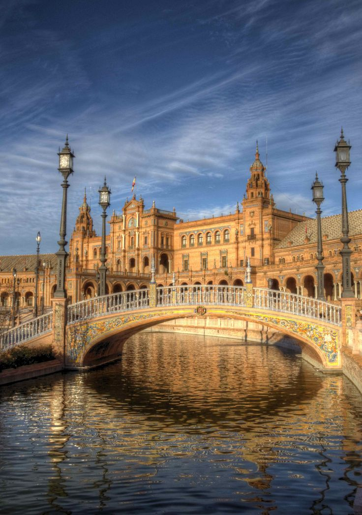 Plaza de España, Seville, Spain, built in 1928 for the Ibero-American Exposition of 1929. It is a landmark example of the Renaissance Revival style in Spanish architecture.