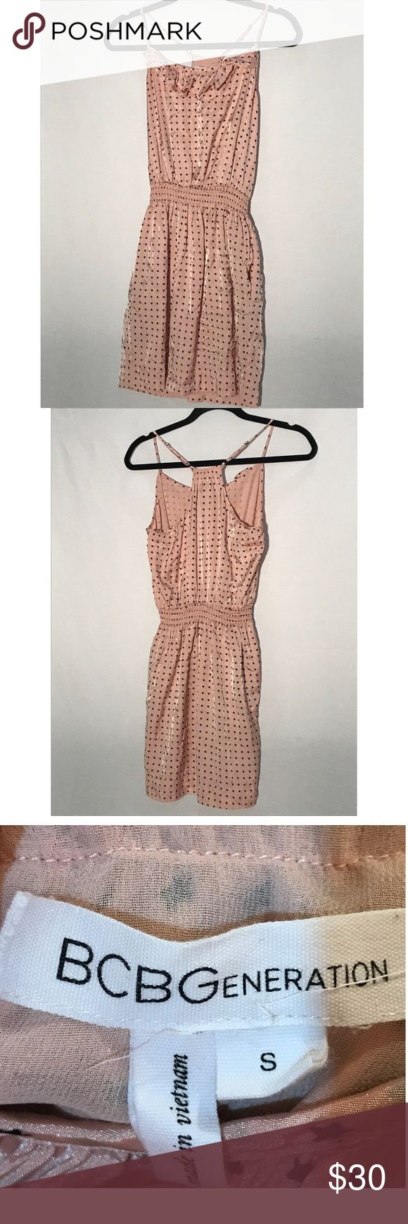 Adorable BCBGeneration pastel pink polka dot dress Adorable BCBGeneration pastel pink and black polka dot (stars) dress. Cute ruffles along the neck line and side pockets!  Elastic waistband. Great condition! BCBGeneration Dresses Mini