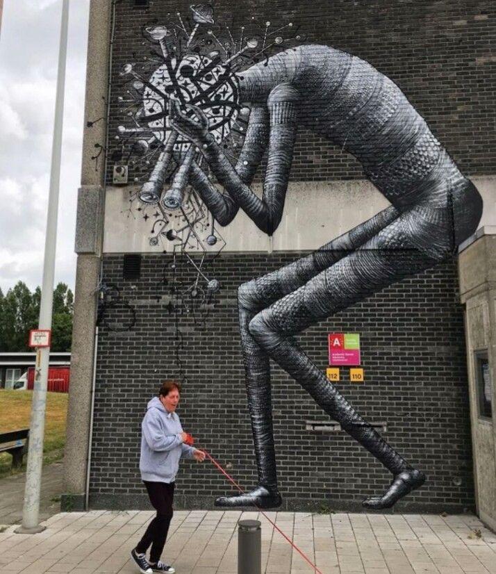 Street Art by Phlegm, located in Antwerp, Belgium