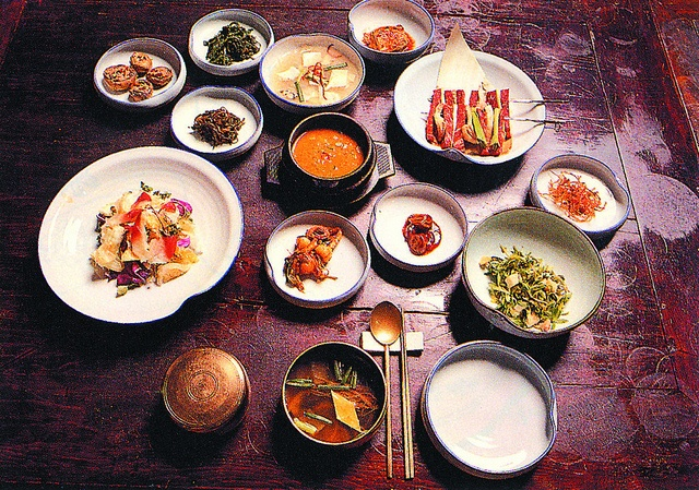 A Spread of Korean Cuisine in Seoul - Korean cuisine is served in generous portions and with banchan (반찬), side dishes, such as various types of kimchi or namul (steam, marinated or stir-fired vegetables).