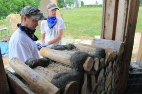 A good perspective of a cordwood wall under construction.