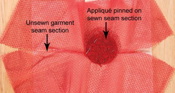 If you're appliquéing a net garment and intend to place any of the appliqués so that they overlap the garment seams, there's a special method for attaching them. Read on to find out how.