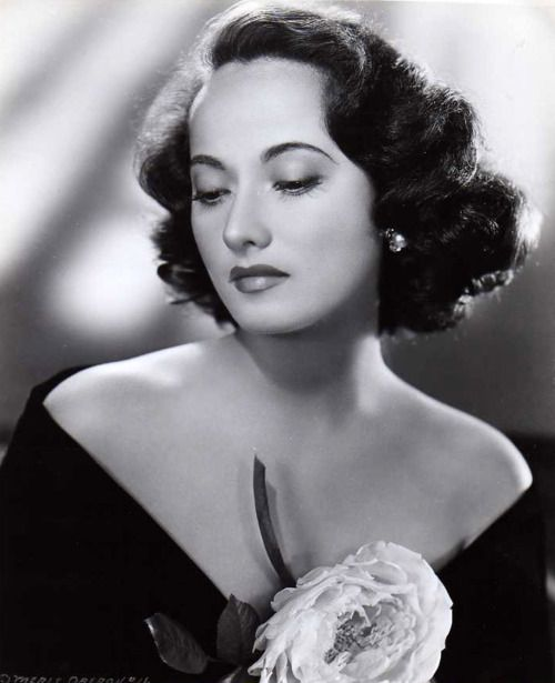Merle Oberon. she talked so fast it was hard to understand her.