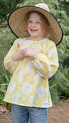 Giggle time! Parasol top in yellow, great for covering up in the sun and helping to protect precious skin. Cool, comfortable, lightweight cotton girls top sizes 1-12 years. Designed in Australia, soft, high quality fabric made exclusively for Three Sun Possums