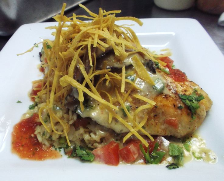 Texas Gulf Red Snapper with Tampico Rice and Portobello Jalapeno Creme from The Black Sheep Bar and Grill in San Angelo Texas...
