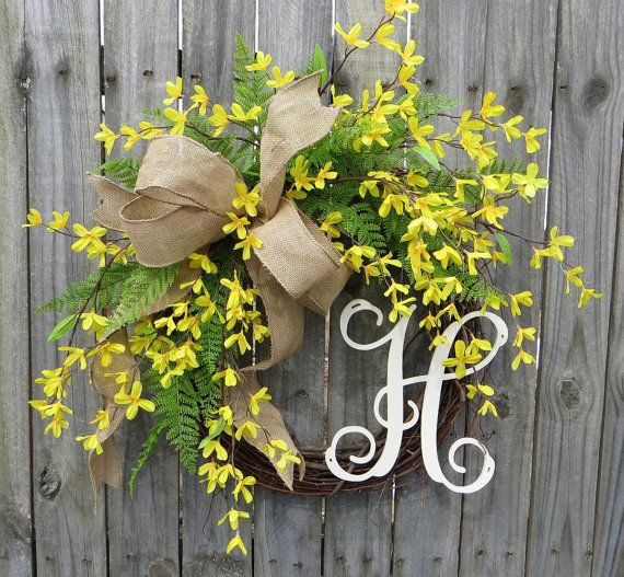 This burlap and forsythia wreath is the perfect personalized accent for spring! A wired burlap creates an informal bow. Beautiful, forsythia and