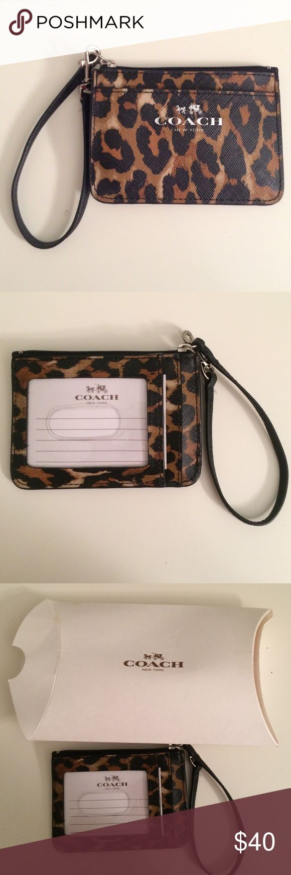 Coach wristlet wallet Cute little wristlet that serves as an id/card holder. Never used before. Still in box Coach Bags