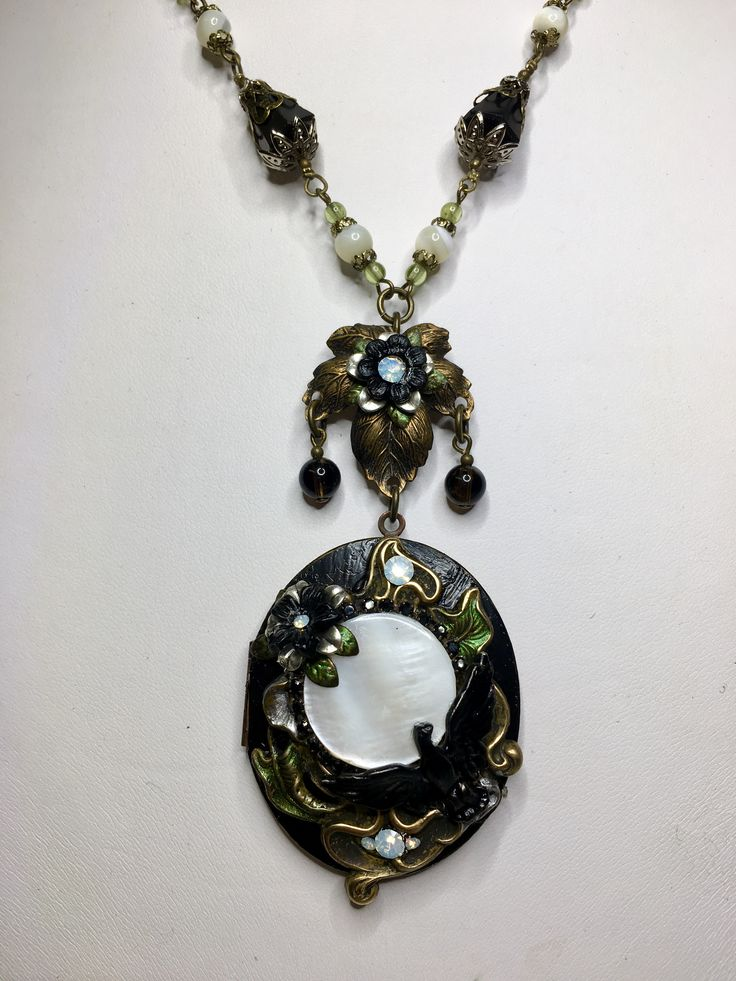 """Raven's Moon"" vintage assemblage locket with antique jet, mother of pearl and peridot by Jeanie Schlegel for Seditious Jewelry on Etsy"