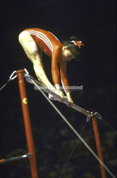 Teodora Ungureanu (Romania) on uneven bars at the 1976 Montreal Olympics