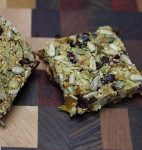 Nut-Free Paleo Chewy Granola Bars | The Paleo Mom.  Ingredients: eggs, vanilla, honey [only 1T], unsweetened coconut, pumpkin seeds, sunflower seeds, sesame seeds, dried apricots, dried cranberries, salt, cinnamon.  Recipe calls for chocolate chips, but you can omit them!