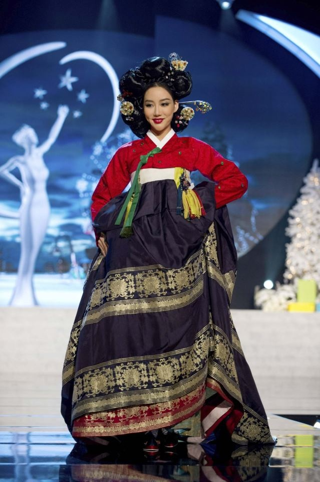 Hanbok - red jeogori and dark blue chima with multiple gold hems over a red underskirt (image: Miss Korea 2012)