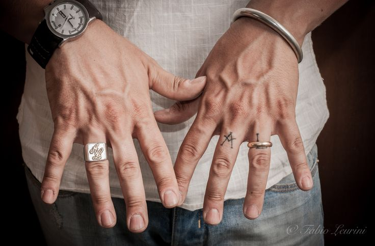 rings and tattoo