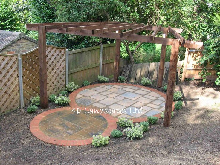 Gorgeous circular patio with pergola from 4d landscape ltd for Small round garden design