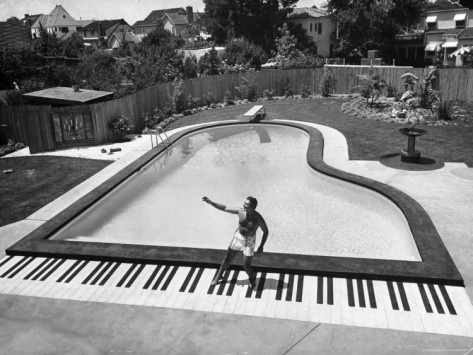 Liberace At The Piano Shaped Pool In