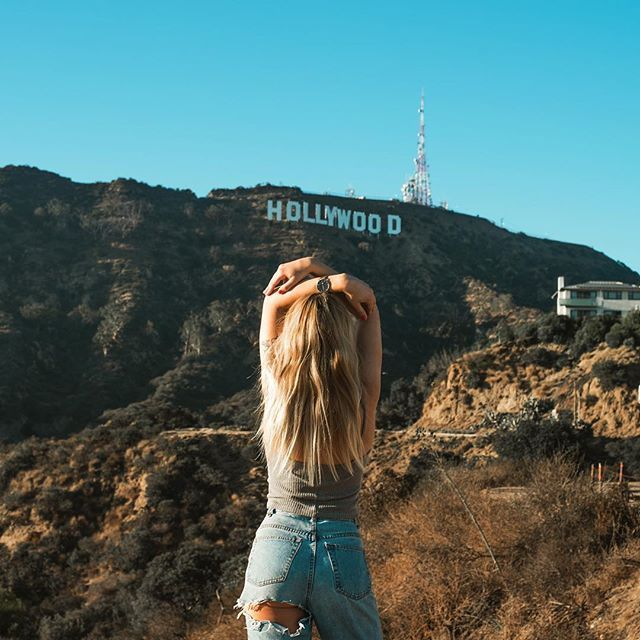 Enjoying the views. Instagram : alexan.thompson Hollywood Sign Los Angeles California babe highwaisted jeans model street style blogger instagram pose blond wavy hair long watch mvmt