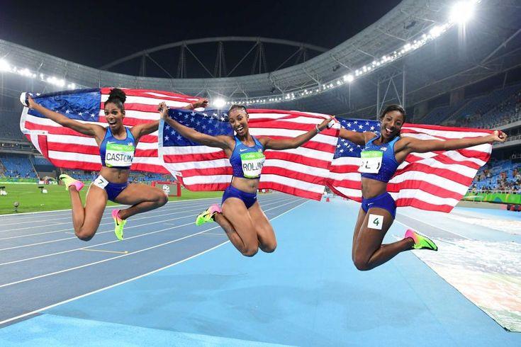 USA's Kristi Castlin, Brianna Rollins and Nia Ali celebrate hurdles medals