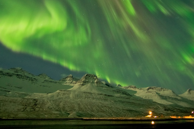 The Northern Lights are seen in the skies near Faskusfjordur on the east coast of Iceland. A solar storm shook the Earth's magnetic field, but scientists said they had no reports of problems with electrical systems.