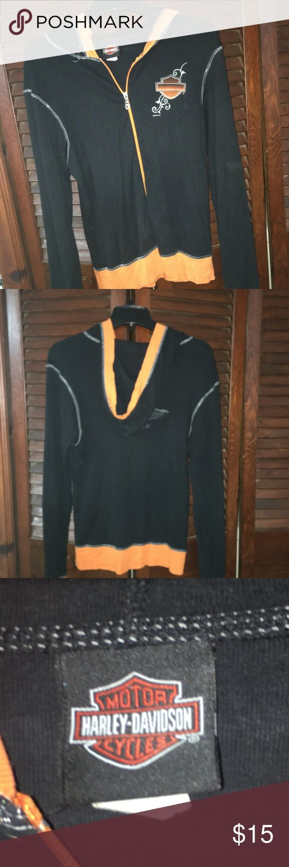 Harley Davidson Zip up Shirt Size Medium This  shirt is in good used condition.  No rips or stains.  Looks cute with an orange tank underneath it.  It is part of a 2 piece set.  It came with lounge pants that I cant find anymore. Harley Davidson Tops Sweatshirts & Hoodies
