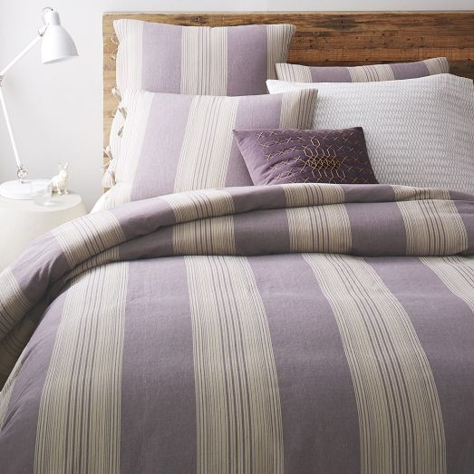Soft stripes. We used yarn-dyed threads on the Coastal Stripe Duvet Cover + Shams to achieve its subtle coloring. Tie closures add a homey feel.