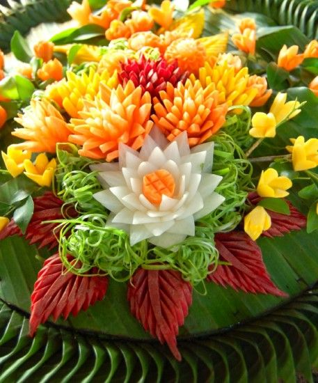 Creatively carved vegetable art atop a banana leaf raft .. celebrations of Thailand's Festival of Lights