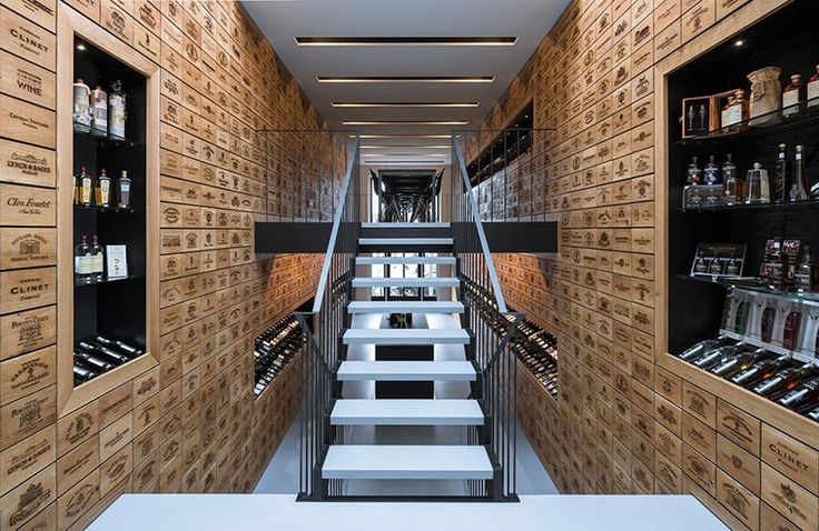 rotterdam wine shop by studio AAAN features laser engraved oak cabinets