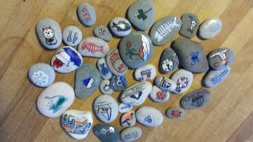 Drawing on the stones from Rhodes seaside