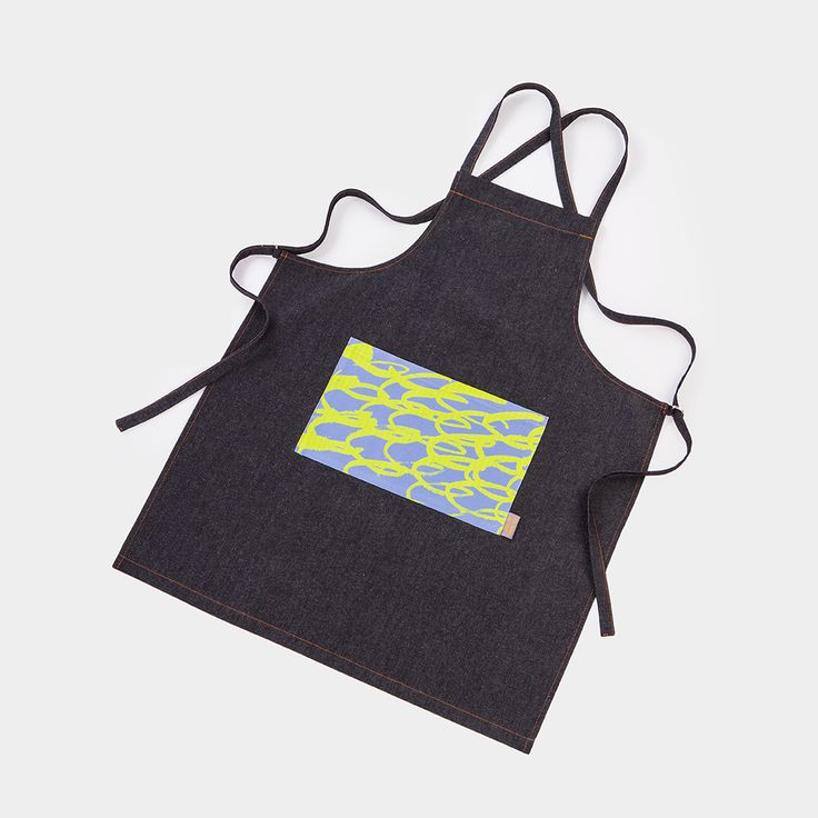 Stylish apron featuring Ella Doran's 'Through the Camera Lens' design, inspired by the lime trees in Lower Park. Featuring a printed pocket and ties at the back.
