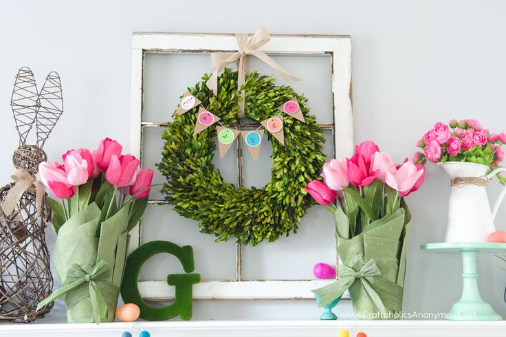 Colorful and Happy DIY Spring Mantle! This beautiful Spring / Easter Mantle is simply delightful. The rainbow felt ball garland is to die for.